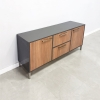 Axis Storage Credenza is shown here with a Gray Gloss Laminate exterior and a Walnut Wood Veneer interior.
