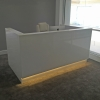 Dallas reception desk is shown here with a White  Gloss Laminate Base, Toe-kick and LED.