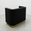 Nola Custom Reception Desk is shown here with a Black Gloss Laminate Base and gold Toe-kick.