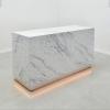 Houston Custom Reception Desk  is shown here with a Faux Stone Finish  Calcutta Laminate Base.