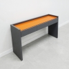 Aspen Console Table with Glass top is shown here with a Dark Gray traceless Laminate Base and Orange Glass top.