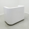 Nola Custom Reception Desk is shown here with a white Gloss Laminate Base and aluminum Toe-kick.